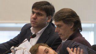 Buscando acuerdos. Los diputados Diego Bossio y Nicolás Massot durante el debate de ayer en la Cámara baja.