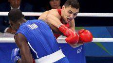 el boxeador yamil peralta no pudo con el cubano erislandy savon y se quedo sin medalla