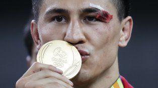 El ruso Roman Vlasov muestra en su rostro las secuelas de la pelea con la que ganó el oro en lucha grecorroamana 75 kilos.