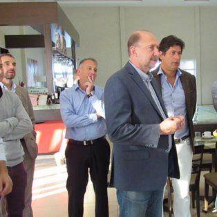 En sintonía. Perotti y Santacroce, con empresarios funenses.