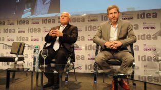 Diálogo. El gobernador Lifschitz y el ministro Frigerio compartieron un panel en el Precoloquio de Idea.