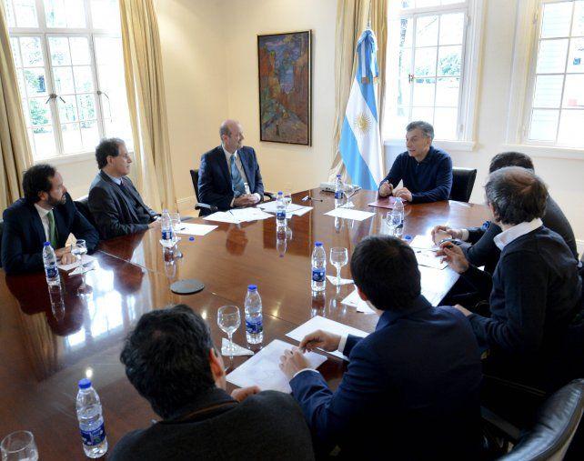 En Olivos. Las autoridades monetarias dialogaron ayer con el presidente.