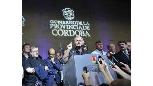 En funciones. El gobernador cordobés tuvo que regresar de apuro al país y hacer frente a la crisis policial y a los saqueos generalizados.