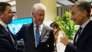 Encuentro. Macri estuvo junto a Bill Clinton y el italiano Matteo Renzi.