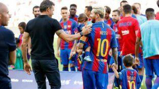 De vuelta. El técnico azulgrana Luis Enrique junto a Messi