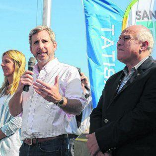 Obra pública. El ministro del Interior, Rogelio Frigerio, y el gobernador Miguel Lifschitz en el lanzamiento del plan del hábitat.