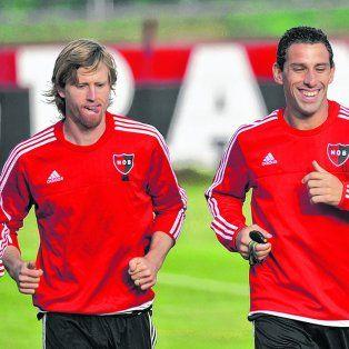 Compinches. Mauro Formica, Diego Mateo y Maximiliano Rodríguez trotan en Bella Vista. Los referentes están felices.