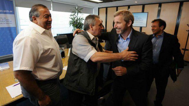 Acuerdo. El ministro Frigerio y el sindicalista Schmid salieron conformes del consenso alcanzado por Ganancias.