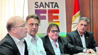 juntos. Contigiani encabezó el acto en la delegación Rosario de Producción.