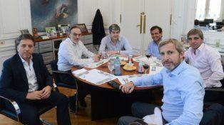 estrategia. Dujovne y Caputo almorzaron con los jefes políticos.
