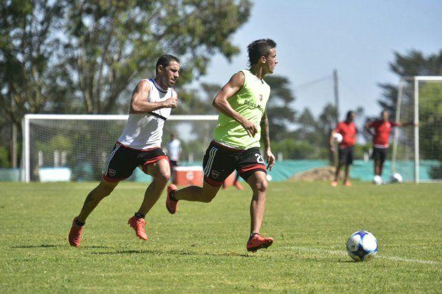 Maxi Rodríguez y Fértoli durante el trabajo táctico de la mañana en Apand.
