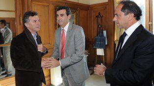 Florencio Randazzo junto a Mauricio Macri y Daniel Scioli. (Foto de archivo)