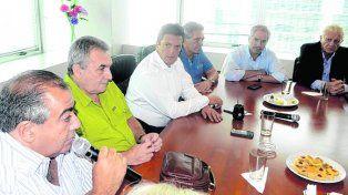 Juntando fuerza. Massa se reunió ayer con los líderes sindicales.