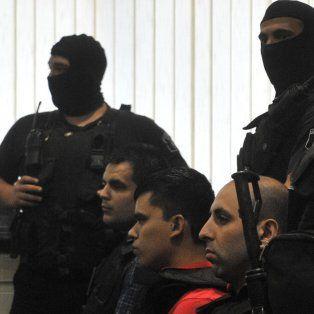 En el banquillo. Damario, Muñoz y Bassi fuertemente escoltados en una de las audiencias del juicio oral.