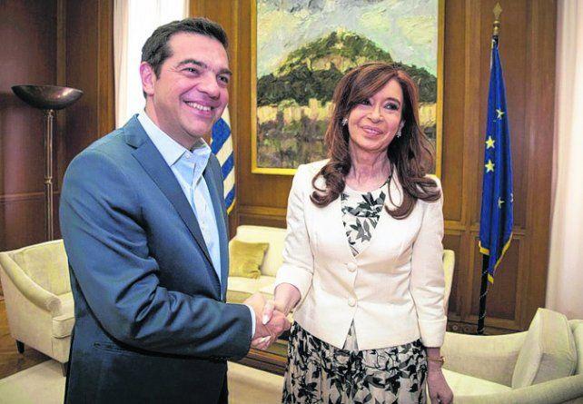 Visita. Cristina saludó ayer el primer ministro griego