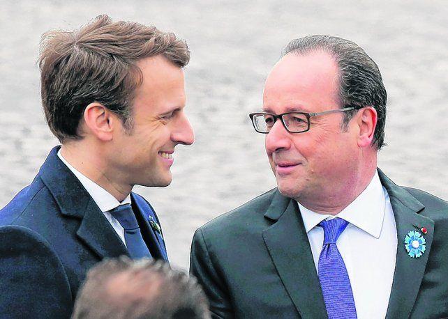 Saludo. Macron y Hollande se vieron ayer por primera vez desde que el joven dejó su gobierno en 2016.