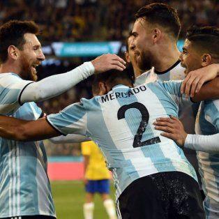 Messi celebra con Mercado, el autor del gol ante Brasil.