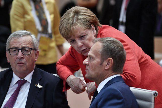 Desafío mundial. Merkel dialoga con líderes de la Unión Europea.