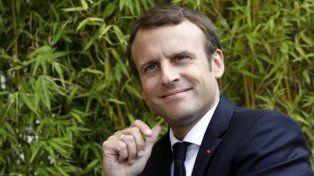 confianza.Emmanuel Macron ayer en los jardines del Elíseo. Apuesta a que la economía crezca con fuerza.