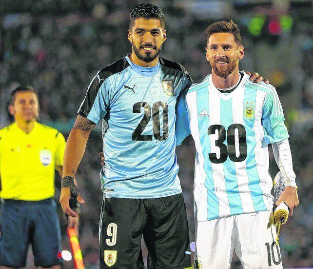 Emblemas de la candidatura. Suárez y Messi