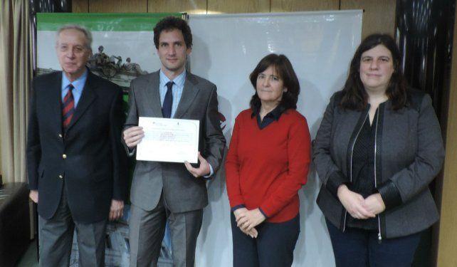 Federico Fernández Niello ( profesional) y los estudiantes Lucas Ford