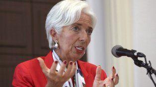 optimista. El organismo que conduce Christine Lagarde prevé que se acelerará la recuperación mundial.