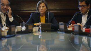 caras sombrías. La titular del Parlament, Carme Forcadell, se reunió ayer con legisladores nacionalistas.