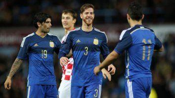 El lateral ex Newells, festejando su único gol en la selección mayor: ante Croacia, en un amistoso en 2014.