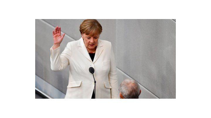 Merkel jura para un cuarto mandato.