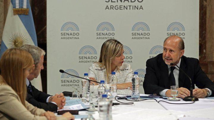 María de los Ángeles Sacnún y Omar Perotti