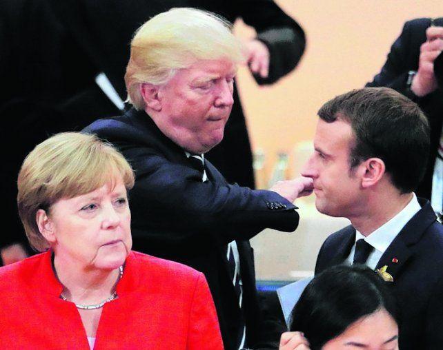 Cumbre. Merkel con Macron y Trump en una reunión del G-7 de 2017.