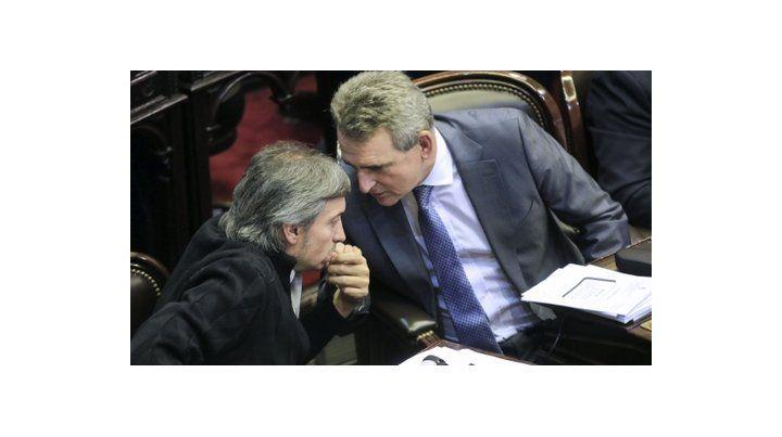 en sus bancas. Kirchner y Rossi