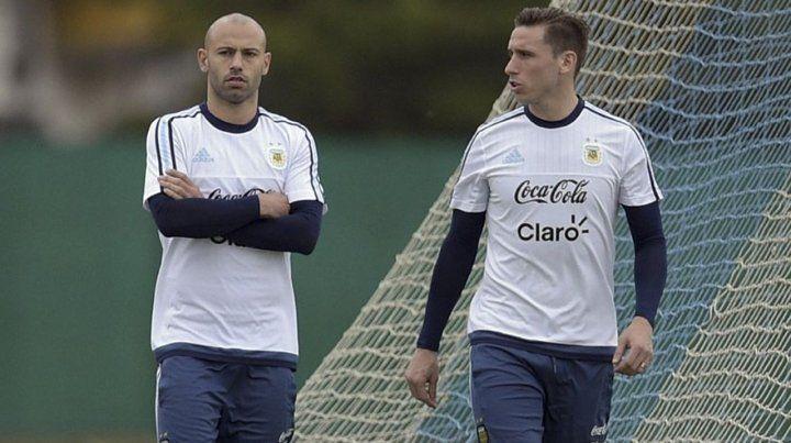 Aliados. Javier Mascherano y Lucas Biglia se repartirán la mitad de la cancha el sábado ante Islandia en Moscú.