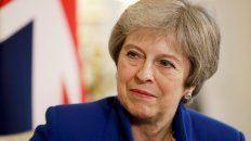 Bajo presión. La premier británica presentará el borrador a su gabinete.