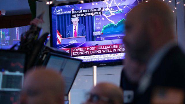 Descontento. Wall Street cayó cuando la FED anunciaba la suba de tasa.