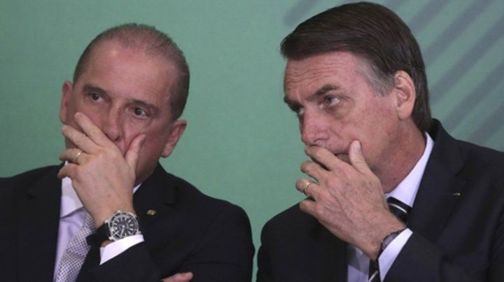 Achique. Bolsonaro junto al ministro de la Presidencia