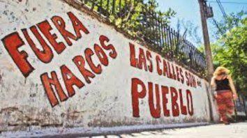Pintadas en paredes de los barrios.