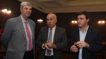 Los jueces Marcelo Escola y Marcelo Molina, y el secretario de Gestión provincial Matías Figueroa, motorizan la adopción,