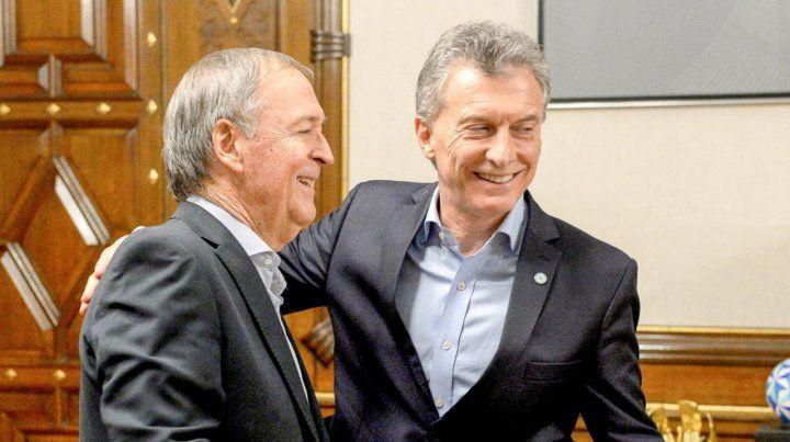Balcarce 50. El cordobés y el presidente sonrieron para la foto.