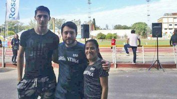 Inseparables. Brian Impellizzieri, el entrenador Martín Arroyo y Yanina Martínez, en el Estadio Municipal, el lugar de entrenamiento.