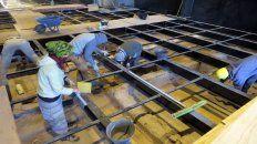 El extraordinario trabajo del equipo de arqueólogos para recuperar los pisos originales.
