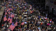 gesto. Las banderas de EEUU, un claro desafío al régimen chino.