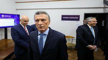 La previa. Espert, Macri y Fernández, pocos minutos antes del debate.