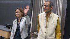 Galardonados. La francesa Esther Dulfo y el indio Abjihit Banerjee.