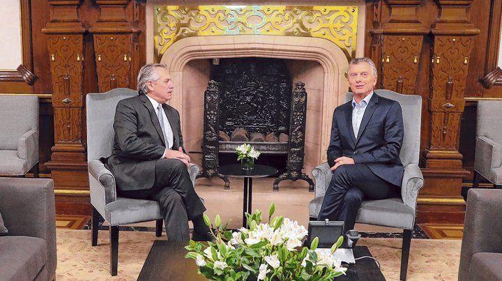 Histórico. Alberto Fernández y Mauricio Macri dejaron ayer formalmente inaugurado el proceso de transición que culminará el 10 de diciembre.