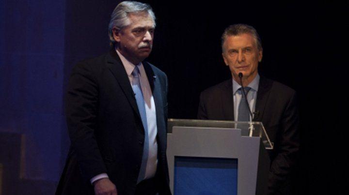 enojados. Alberto Fernández y Mauricio Macri dan señales de una transición ahora conflictiva.