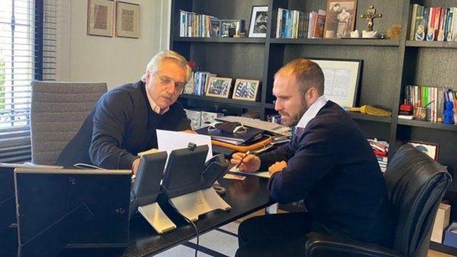 Definiciones. Fernández y Guzmán pilotean la negociación de la deuda externa en un momento difícil.