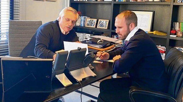 control. El presidente y Guzmán analizan la negociación por la deuda.