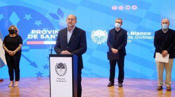 Omar Perotti y Pablo Javkin, en el anuncio del regreso a la cuarentena estricta en Rosario.