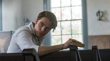 Robert Pattinson interpreta a un predicador que esconde muchos secretos.